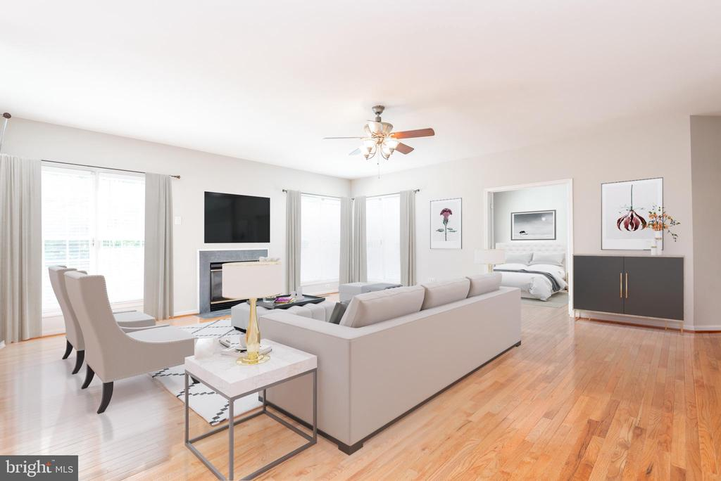 Light-filled living room with virtual staging - 6033 SUMNER RD, ALEXANDRIA