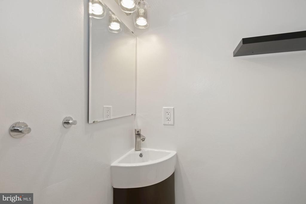 Powder room on the main level - 1813 HERNDON ST N, ARLINGTON