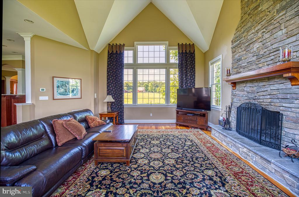 Wood burning fireplace with floor to ceiling stone - 12788 BARNETT DR, MOUNT AIRY