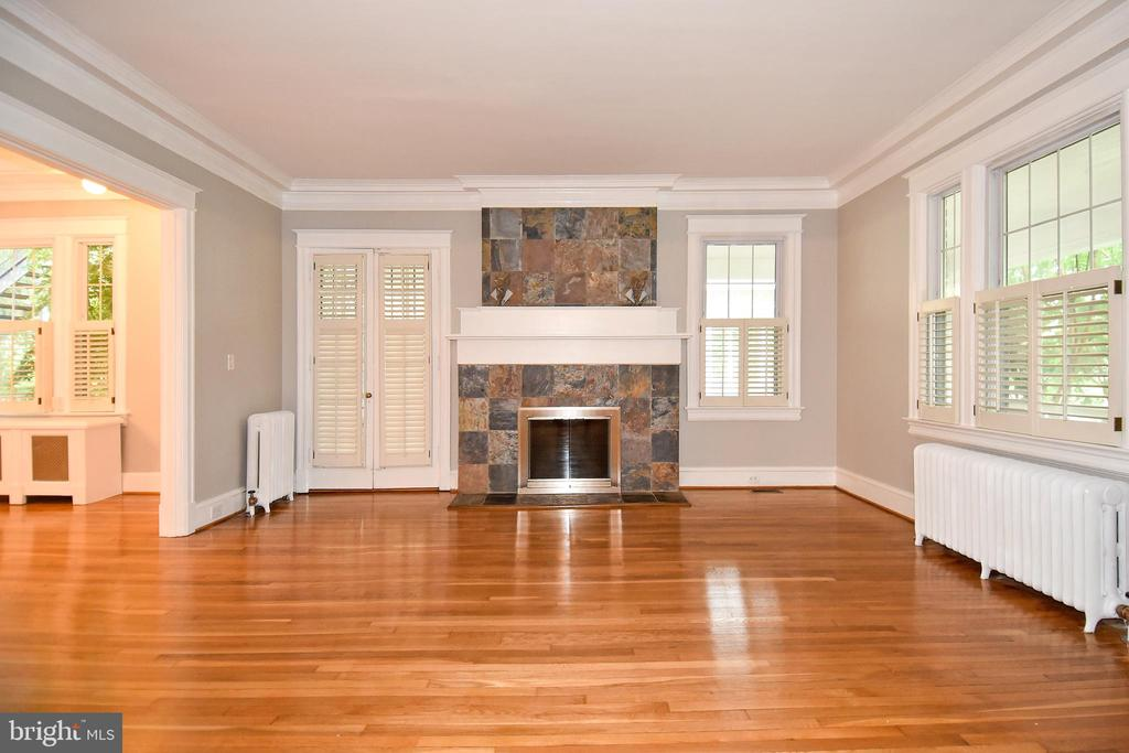 Wood burning fireplace and doors to side porch - 5603 16TH ST NW, WASHINGTON