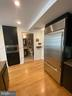 View over oversized refrigerator and built in micr - 1700 CLARENDON BLVD #141, ARLINGTON