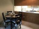 Galley kitchen open to living area - 3301 S LEISURE WORLD BLVD #99-1G, SILVER SPRING