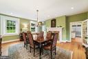 Formal Dining Room with view past fireplace - 19200 ORCHARD MANOR LN, LEESBURG
