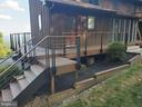 Extensive Trex decking with custom cable rails - 5520 BOOTJACK DR, FREDERICK