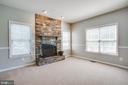 Living room with stone fireplace - 35187 PHEASANT RIDGE RD, LOCUST GROVE