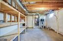 storage room with built in shelves - 35187 PHEASANT RIDGE RD, LOCUST GROVE
