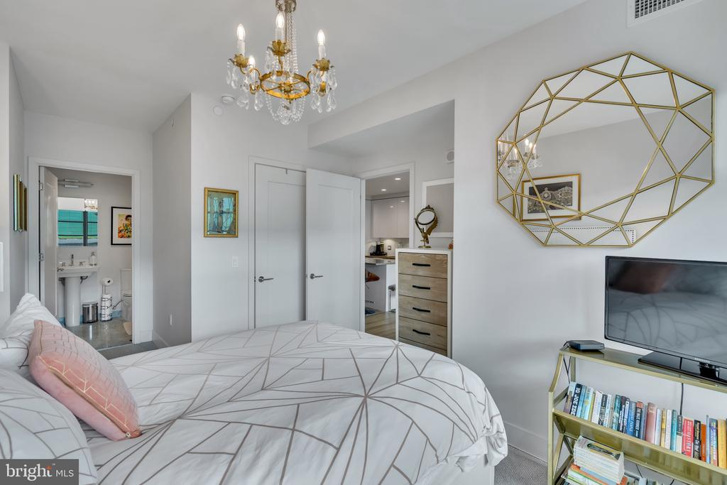 chandelier is a beautiful touch in owner's suite - 45 SUTTON SQ SW #1104, WASHINGTON