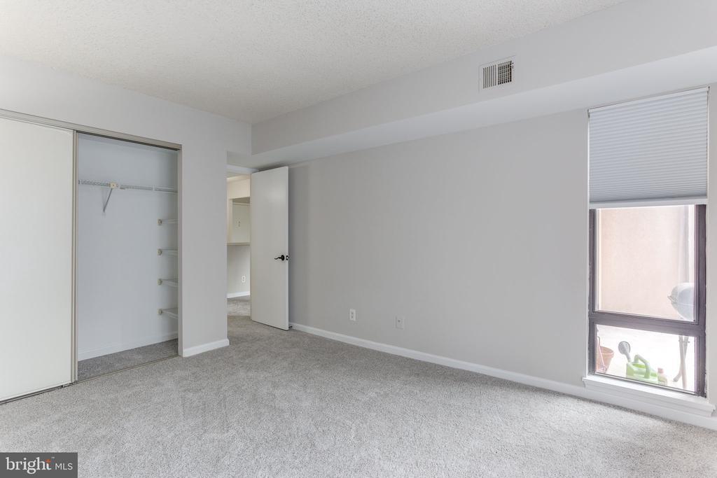 Bedroom closet with built-in shelves - 805 N HOWARD ST #336, ALEXANDRIA