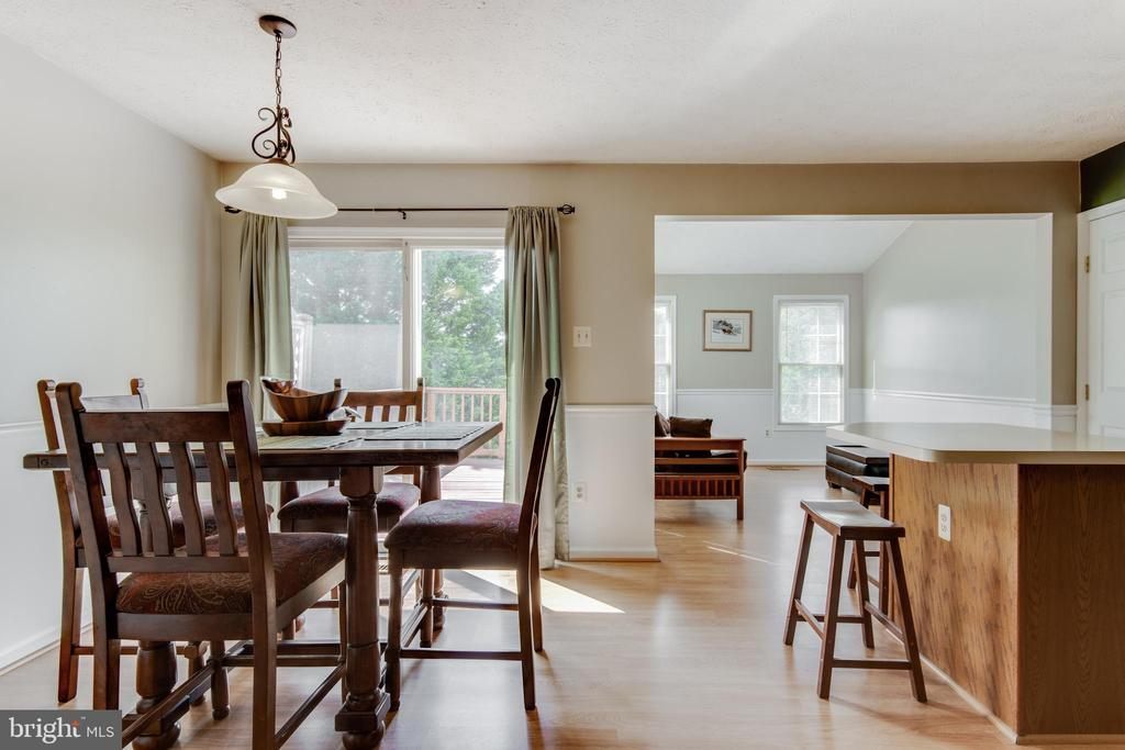 Large dining area looks out onto  deck - 8873 OLD SCAGGSVILLE RD, LAUREL