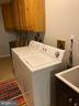 Laundry room includes lots of storage & a mud sink - 4147 SUMERDUCK RD, SUMERDUCK