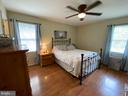 Master bedroom with lots of natural light! - 4147 SUMERDUCK RD, SUMERDUCK