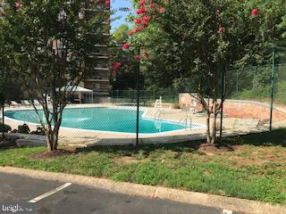 Relaxing outdoor pool... - 1900 LYTTONSVILLE RD #306, SILVER SPRING