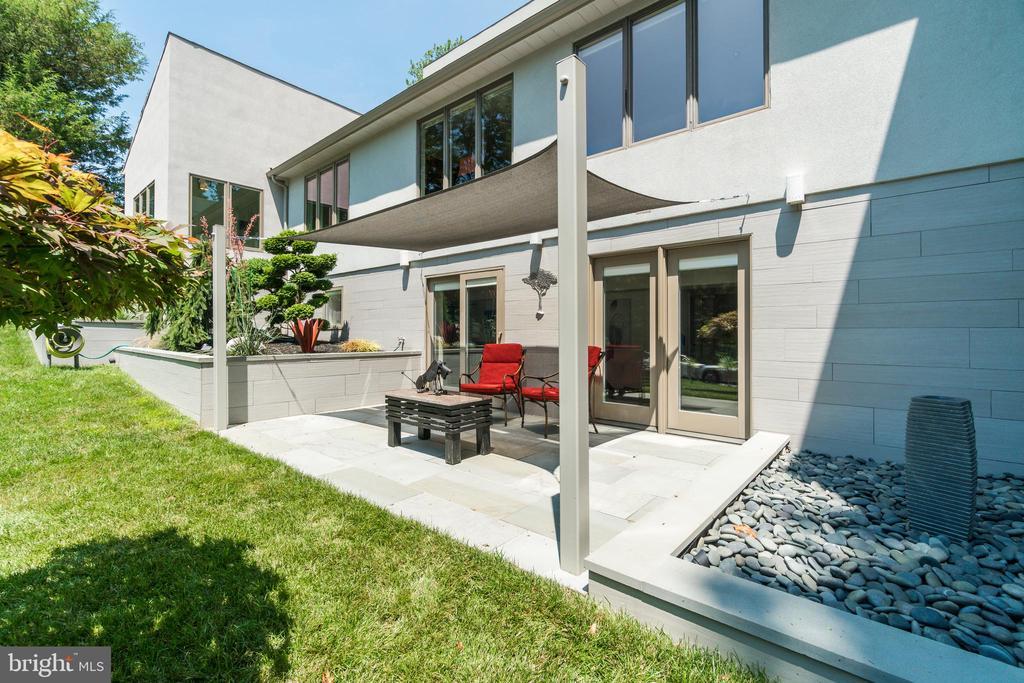 Water feature + patio extends the bottom floor.... - 13814 ALDERTON RD, SILVER SPRING