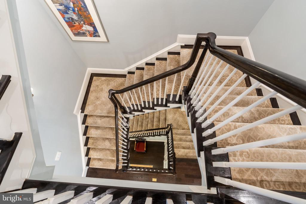 Open staircase, large enough to add an elevator - 1845 POTOMAC GREENS DR, ALEXANDRIA