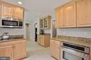 Kitchen - Loads of Cabinets + Counter Top Space! - 9522 BACCARAT DR, FAIRFAX