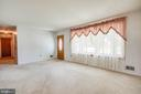 Large living room features a gorgeous bay window - 6920 RUSKIN ST, SPRINGFIELD
