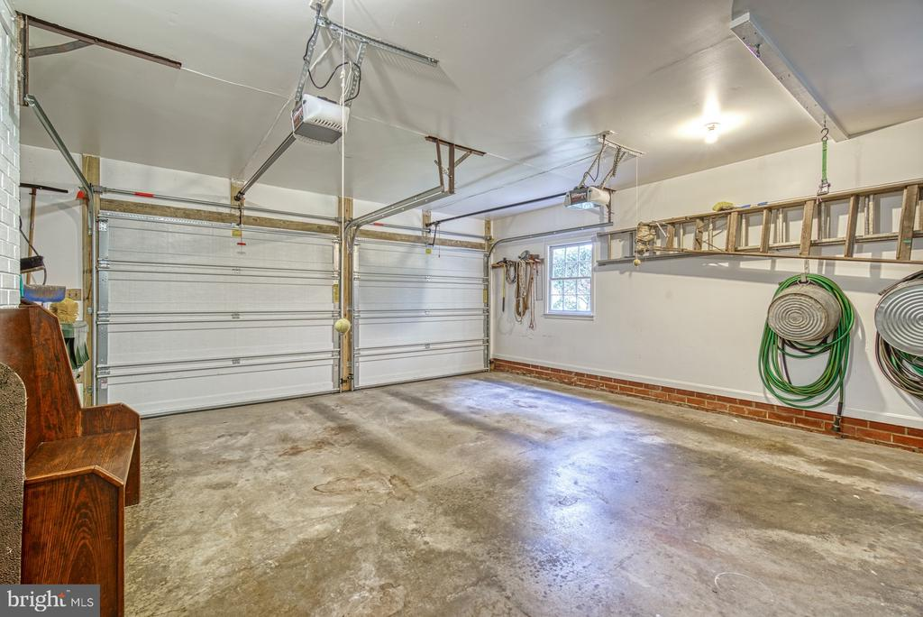 Two car garage with ample space for storage - 8415 FROST WAY, ANNANDALE