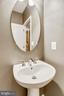 Half bath on lower level. - 20385 BELMONT PARK TER #112, ASHBURN