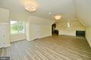 Carriage house living/dining room view to kitchen - 40483 GRENATA PRESERVE PL, LEESBURG