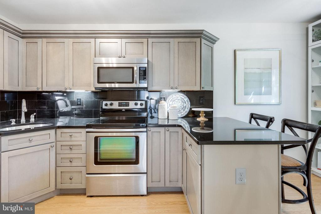 Renovated Kitchen (2018) features island seating & - 1741 N TROY ST #8-430, ARLINGTON