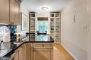 Kitchen offers plenty of cabinets for storage - 1741 N TROY ST #8-430, ARLINGTON
