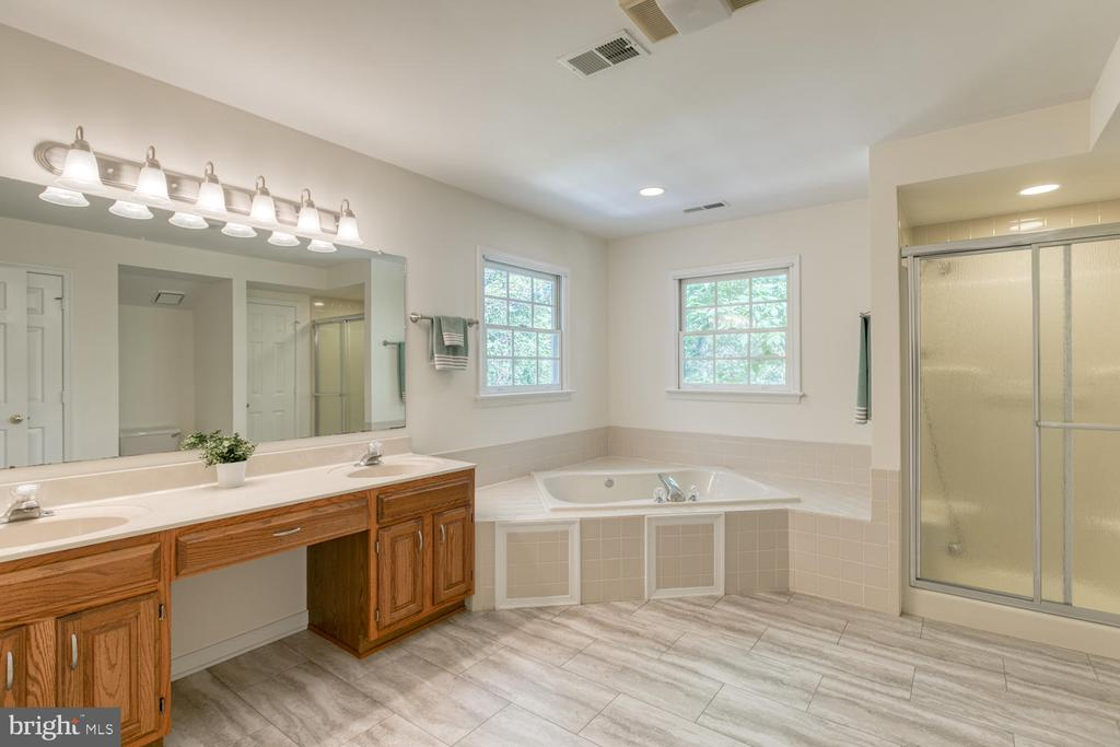 Master bathroom with new luxury vinyl plank - 2305 HARPOON DR, STAFFORD