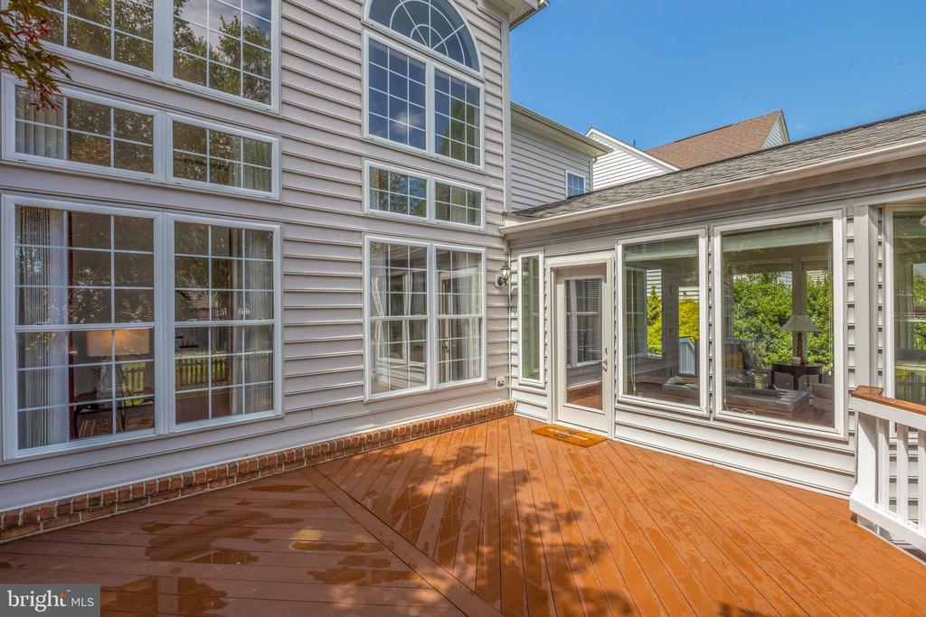 IPE Wood Deck view into Sunroom - 22749 HIGHCREST CIR, BRAMBLETON
