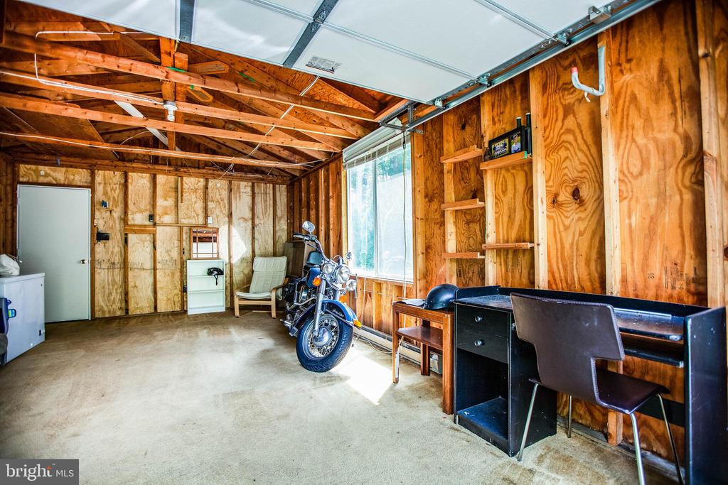 View inside the oversized one car garage - 413 LIBERTY BLVD, LOCUST GROVE