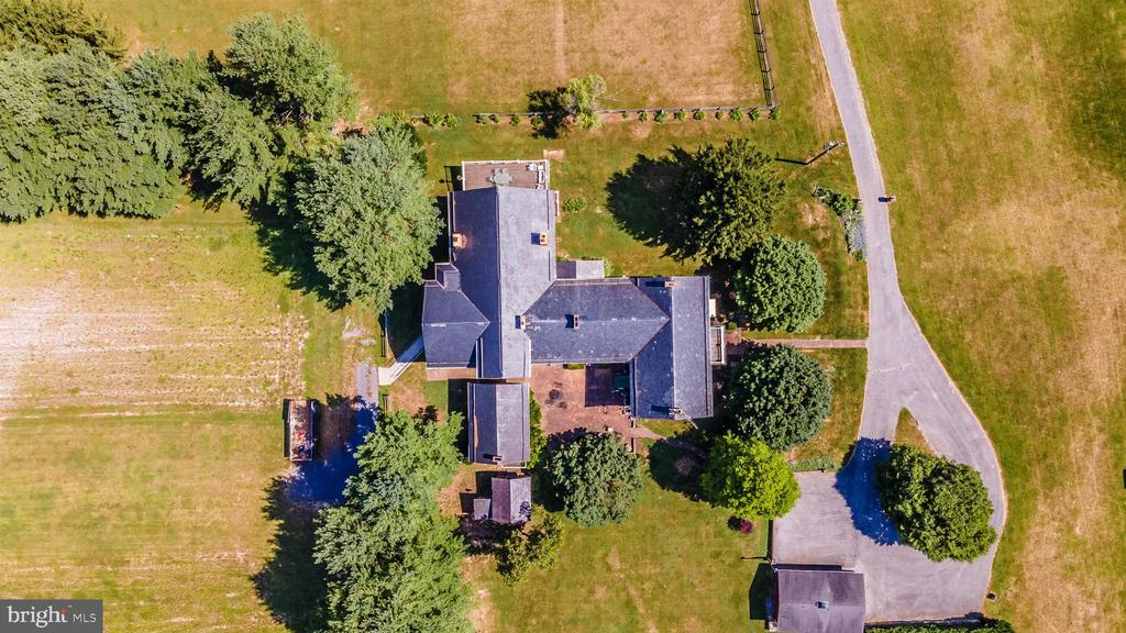 Aerial view of the mansion and circular driveway. - 7030 DRUMMINE RD, MOUNT AIRY