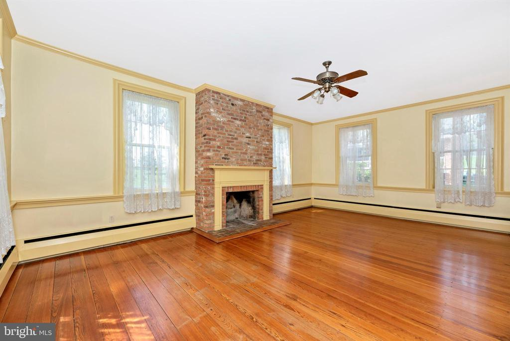 1st floor library with woodburning fireplace. - 7030 DRUMMINE RD, MOUNT AIRY