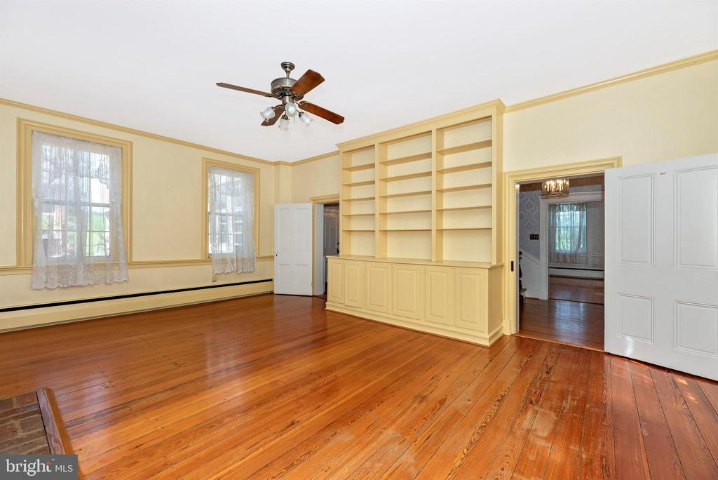 Library entrances that open to the foyer. - 7030 DRUMMINE RD, MOUNT AIRY