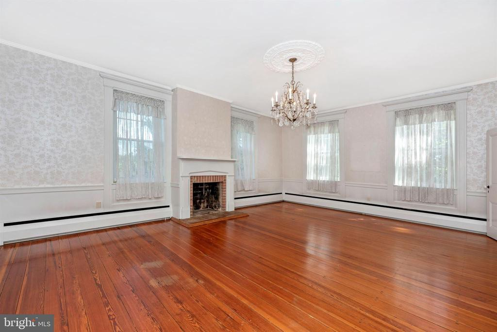 Formal grand living room. Wood fireplace. - 7030 DRUMMINE RD, MOUNT AIRY