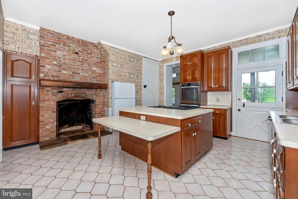 Kitchen open to DR and ballroom w wood fireplace. - 7030 DRUMMINE RD, MOUNT AIRY