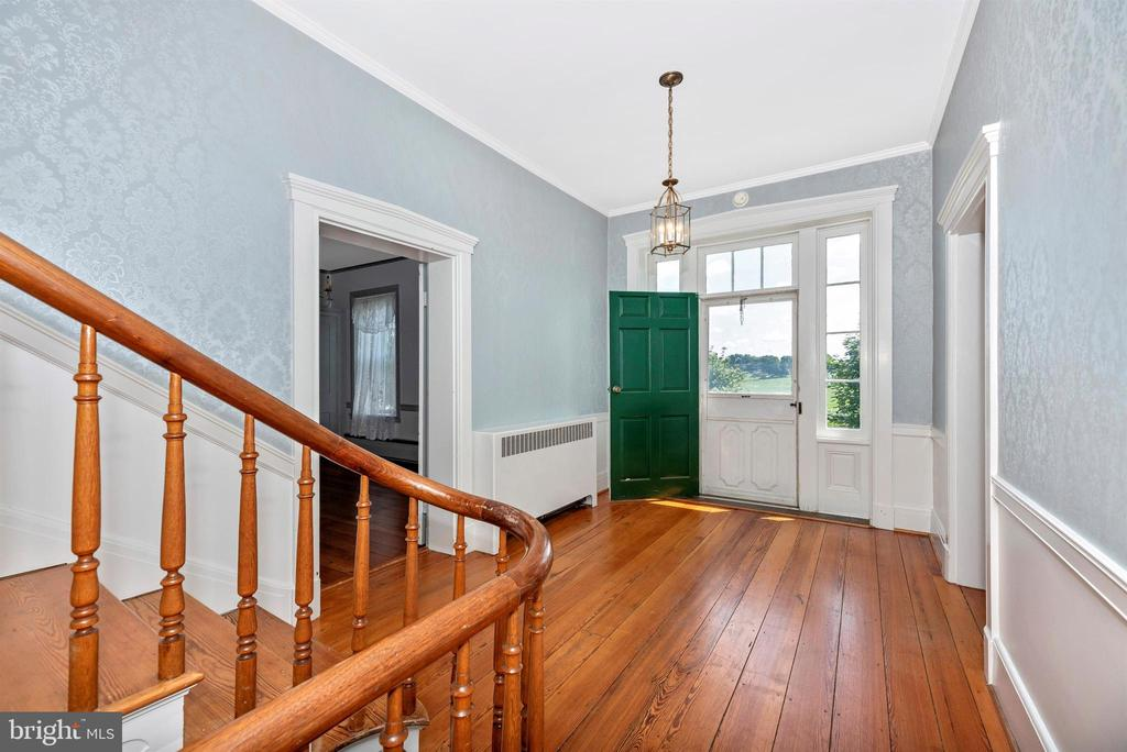 Gorgeous 2nd floor foyer and original hardwoods. - 7030 DRUMMINE RD, MOUNT AIRY