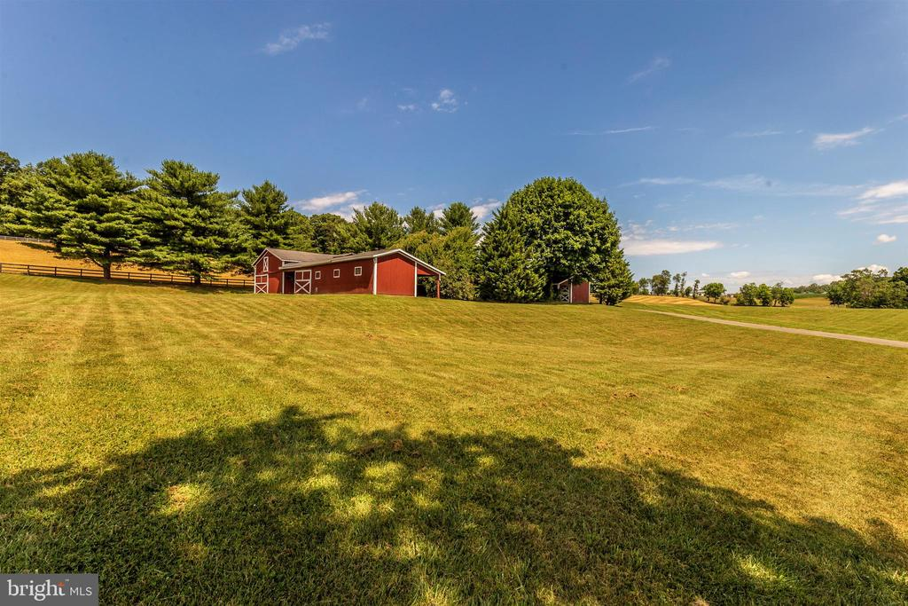 Horse barn, machine shop, office, tack, bathroom. - 7030 DRUMMINE RD, MOUNT AIRY