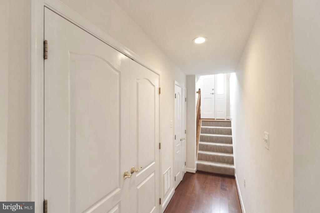Lower level Hall w/ Bamboo flooring - 255 TOWN BRANCH TER SW, LEESBURG