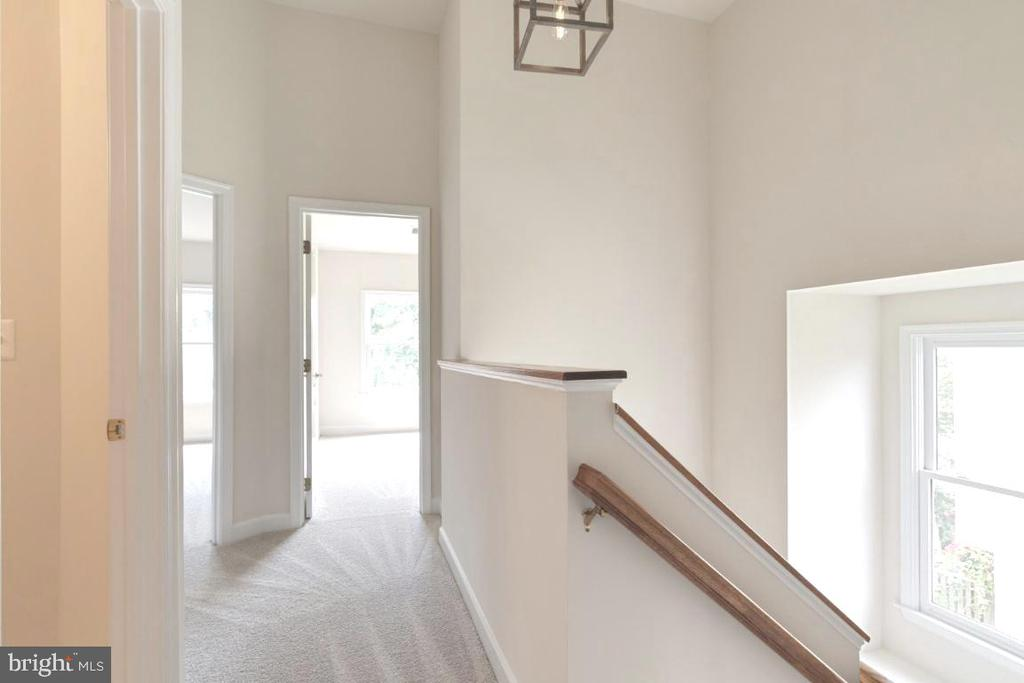 Upper level hall with new light fixtures - 255 TOWN BRANCH TER SW, LEESBURG
