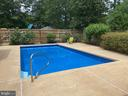 Pool surrounded by landscaping - 8333 BLOWING ROCK RD, ALEXANDRIA