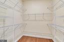 Master walk-in closet with lots of shelving. - 19433 SASSAFRAS RIDGE TER, LEESBURG