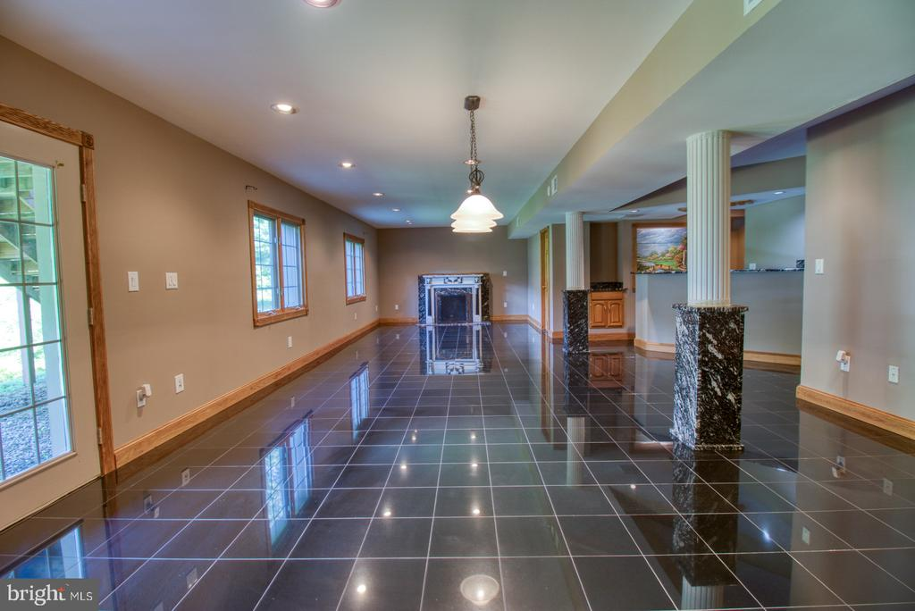Lower level with marble floors, bar and more - 14016 HARRISVILLE RD, MOUNT AIRY