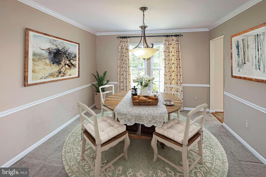 The formal dining room...or a study? - 18728 POTOMAC STATION DR, LEESBURG