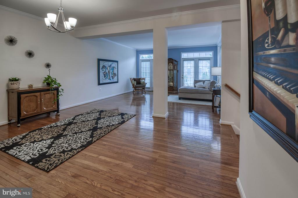 Open Floor Plan Leading to Balcony off Living Room - 2406 RIPPLING BROOK RD, FREDERICK