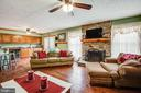 Family Room off the Kitchen with Stone Fireplace - 1546 W OLD MOUNTAIN RD, LOUISA