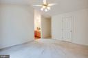 Master bedroom with ceiling fan - 11717 COLLINWOOD CT, FREDERICKSBURG