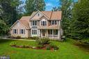 Lovely colonial on 14 acres tucked among trees gal - 30831 PORTOBAGO TRL, PORT ROYAL