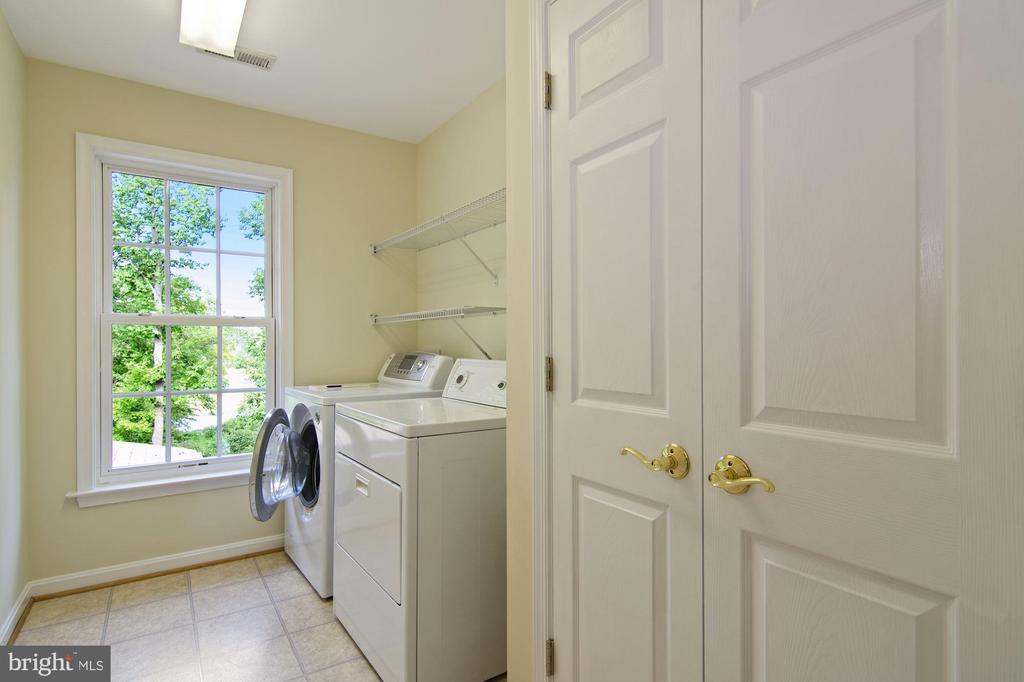 large laundry room with double closet storage - 30831 PORTOBAGO TRL, PORT ROYAL