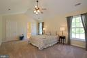 master bedroom with vaulted ceilings - 30831 PORTOBAGO TRL, PORT ROYAL