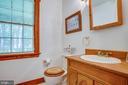 Main-level half bathroom - 50 CEDAR OAKS LN, FREDERICKSBURG