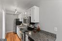 Microwave, fridge/freezer, granite, and stove. - 1801 KEY BLVD #10-506, ARLINGTON
