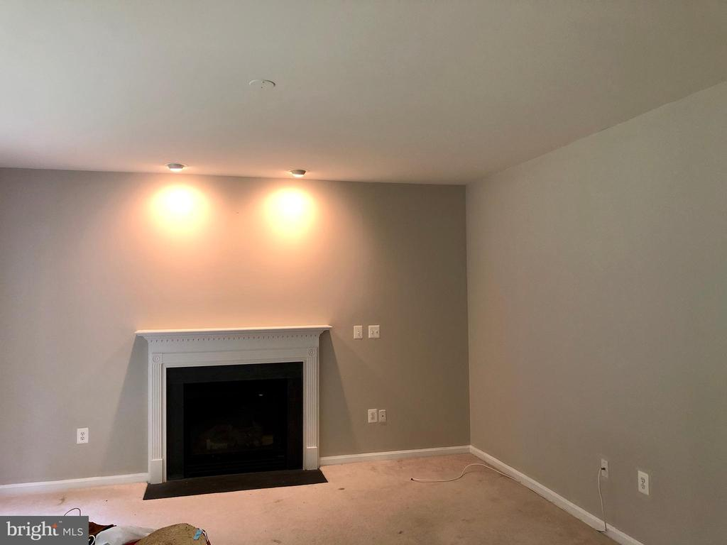 Family room with fireplace and recessed lights - 76 BRENTSMILL DR, STAFFORD